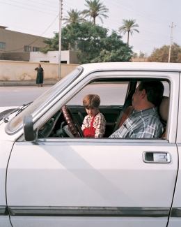 Baghdad, kid in parking car, 6 months prior to 2nd Iraq War