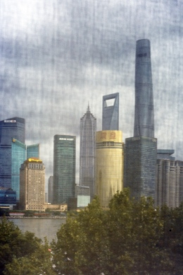 Shanghai Skyline seen from 3 on the Bund through window mash