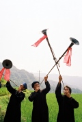 Miao village men greeting guest with trumpets, close to Duyun