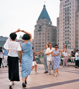 Shanghai, People dance on the  Bund in front of the Peace Hotel