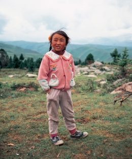 little girl, helping taking care of her family's Yaks, mountain side, Tagong Sichuan