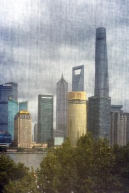 Shanghai Skyline seen from 3 on the Bund through window mash