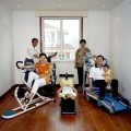 Huaxi, Communist Villages, Work Out Room with Model Family in their Model Home, Stern