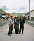 3 men on village main road, Tagong Sichuan